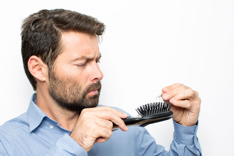 man-finding-loss-of-hair-in-brush