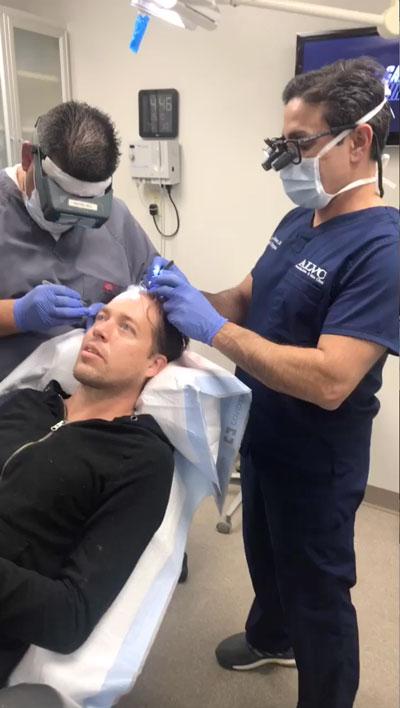 A patient receiving hair loss treatment